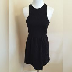 """Free People Fit & Flare Dress size XS NWOT Free People Black fit and flare dress in XS, NWOT. There is an embossed paisley/floral pattern in the fabric. Dress is 32"""" from shoulder to hem. Made from 82% cotton, 14% polyester and 4% spandex, so there is stretch. Please ask if you have any questions. Dresses"""