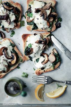 Toast with mushrooms, spinach and mozzarella.
