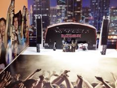 My boss' birthday. He loves metal music. I put these mini-pop-up-stage on his desk.