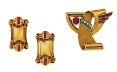 A diamond and ruby brooch, of polished and textured scroll design set with cabochon ruby and rose-cut diamond collar and calibré ruby three row spray, 3.5cm long; a pair of citrine and ruby brooches, each rectangular-cut citrine to scrolling terminals with calibré ruby line detail, 3.0cm long, circa 1940