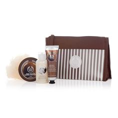 Make someone feel beautiful from head to toe this festive season with The Body Shop's Coconut Beauty Bag Gift Set. Filled with tropical coconut scented treats, this sweet set makes for an ideal holiday gift. Blended with Community Fair Trade organic virgin coconut oil from Samoa, this Shea Beauty Bag Gift Set is perfect for all you Secret Santas and stocking stuffers out there! Includes Mini Coconut Shower Cream, Mini Coconut Body Butter, Mini Coconut Hand Cream, & Cream Mini Crinkle Bath…