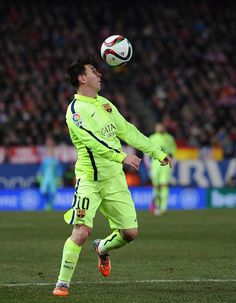 Lionel Messi of FC Barcelona in action during the Copa del Rey Quarter Final Second Leg match between Club Atletico de Madrid and FC Barcelona at Vicente Calderon Stadium on January 28, 2015 in Madrid, Spain.