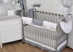 Grey and White Mini Dots on a custom Padded Crib Rail Guard & Blanket coordinate with larger dots on the lampshade