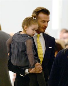 David Beckham and Harper Beckham arrive to watch the presentation of Victoria Beckham's fashions during the Mercedes-Benz Fashion Week Fall/Winter 2014 shows in New York City on Feb. 9, 2014.RELATED: Brad Pitt's changing looks