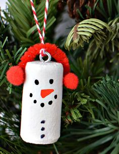 DIY Wine Cork Snowman Christmas Tree Ornaments - - Make snowman Christmas tree ornaments using recycled natural wine corks, paint and fleece! These wine cork Christmas ornaments are easy to make. Cork Christmas Trees, Diy Christmas Decorations For Home, Christmas Ornament Crafts, Handmade Christmas, Holiday Crafts, Christmas Crafts, Christmas Snowman, Ornament Tree, Snowman Tree