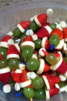 Layer a mini marshmallow, strawberry, banana slice and grape on a toothpick and presto.... you have a Grinch Kabob!