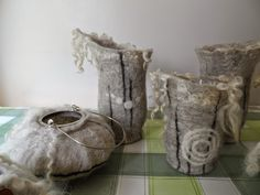 Over the last couple of weeks I've been tinkering around, felting lanterns from Swaledale.