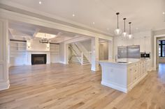 Alair Homes | Burlington | Poplar Drive | 5,300 sqft | This 5 bedroom, 4 bathroom spacious custom home features a spectacular dining room, open concept kitchen and great room, and expansive master suite. The homeowners put in a lot of personal touches and unique features such as a full pantry and servery, a large family room downstairs with a wet bar, and a large dressing room in the master suite.
