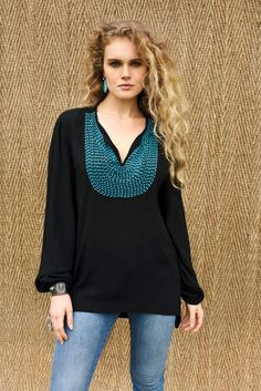 "Ooh, I like how they did the embroidery on the yoke. ""Shapeshifter"" black and turquoise blouse 