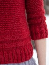 Simple garter stitch is punctuated by textural bands of stockinette above the ribbed edgings of this easy pullover.