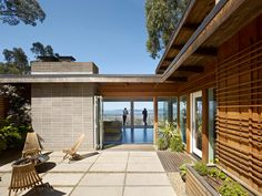 Mid-century modern home renovation in Berkeley Hills. Exterior finishes, wood and concrete. 1960's home.