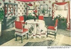 "We instantly know that the focal point of the room is the dining table and chairs — because it is in the center of the room and has been ""pointed to"" with the linoleum inlaid floor. It is only after we have taken in the table that our eyes wander to the red draperies, the pie cabinet and yes — the red ceiling. This room is so 1940s decorating style."