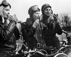 ladies motorcycle gang, 1950's  Checking lipstick is a must to keep our lips covered up ... From the wind