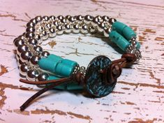 Three strands of silver plated beads with turquoise fashionably placed at the closure. Copper and turquoise patina button with reddish brown distressed leather for closure. Adorable on and will go with everything you own. Sizing available. Please leave wrist size at checkout.
