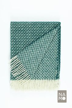 ☛ COMPOSITION: 100% wool ☛ SIZE: 140 cm x 200 cm (incl. fringes) / 55 inches x 79 inches (incl. fringes) ☛ ABOUT THE BLANKET: This cosy NAMO studio Christmas fern forest green throw blanket is made from 100% sheep wool. Its beautiful wide classic chevron / herringbone pattern will be a fun pop of colour in your living room or bedroom decor and it will also keep you warm and cosy. This blanket also comes in Red, Yellow and Blue. #namostudio #hometextile #emeraldgreen #woolblanket #bohodecor