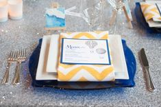 """This color scheme. The yellow and white chevron, the cobalt blue charger. I am dying, I love it so much. My sis-in-law actually did an illustration for this """"inspiration shoot."""" Click through to the rest of the photos...this is what I want MY wedding to look like."""