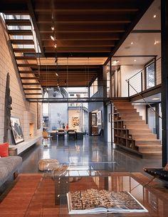 Concreto polido, estruturas à mostra e elementos de aço e metal - Ambiente mais elegante.