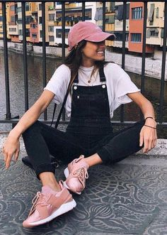 spring outfit idea pink hat   tee   denim jumpsuit   sneakers
