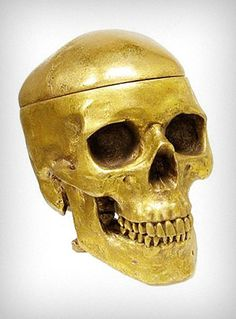 Gold Human Skull Shaped Box. I have absolutely NO NEED for such an item, but it's flipping cool :)
