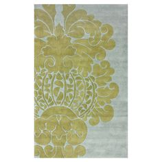 Create a lively atmosphere in your home with this lovely hand-tufted wool rug, featuring a scrolling medallion-inspired motif in gray and yellow.