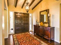A beautiful entryway of a Spanish style home.