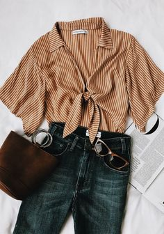 collar tie front striped blouse, rings on purse