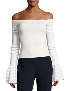 """Gryffin Off-the-Shoulder Bell-Sleeve Knit Top by Alexis. Alexis """"Gryffin"""" knit top with tiered ladder-stitch details. Off-the-shoulder neckline. Long sleeves; bell cuffs. Hem..."""
