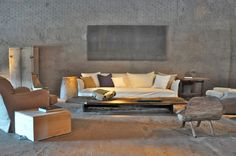 Axel Vervoordt interior. Neutral colours, relaxed style. Apparent finishes: linen, oak, waney edge timber, bronze, concrete.