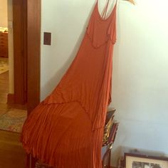 FREE PEOPLE BEACH Burnt Orange Layered Maxi Dress Re-posh! Good preowned condition but never worn by me. Rare find; tied at neck for better fit. No other flaws/alterations to note. *2nd photo is for modeling purposes only. Dress being sold is in pics 1,3, and 4. Free People Dresses Maxi