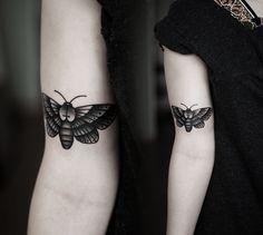 moth tattoo by Kamil Czapiga i like how simple it is