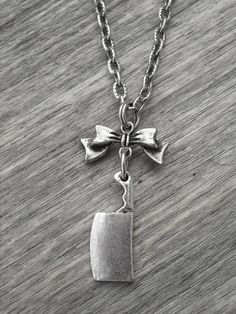 Butcher Knife & Bow Necklace by InkandRoses13