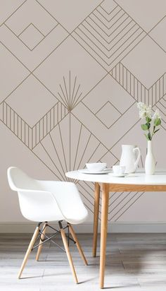 On the lookout for sophisticated wallpaper designs? This Art Deco inspired wallpaper is oozing with style and elegance. Set against a pale pink background, iconic Art Deco motifs help to create visual interest for your walls. Pair with rose gold accessories for a truly luxurious feel. #artdeco