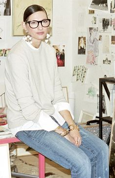 Jenna Lyons in jeans, a sweater, and statement earrings.