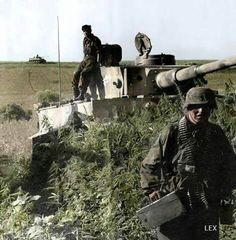 A PzKpfw VI Tiger & supporting infantry.