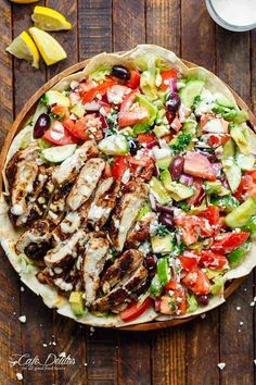 A Chicken Shawarma Salad served on flatbreads, with a 3-ingredient garlic yogurt sauce as a dressing! Easy to make and full of Shawarma flavor!