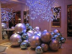 Christmas Decorating Ideas Hanging silver or clear ornaments with blue lighting!