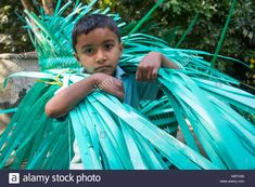 Download this stock image: Manikgonj, Bangladesh. 7th Feb, 2018. A village man is working weave in the city. The man's profession was bamboo or cloth weaving, but in the town he did not get any bamboo or cloth yarn, he chose to do the knitting wastage plastics. Today he and his children are all working together with plastics. There are so many families in this area who live their lives in such a way. Credit: Jahangir Alam Onuchcha/Alamy Live News - M2FG56 from Alamy's library of ...