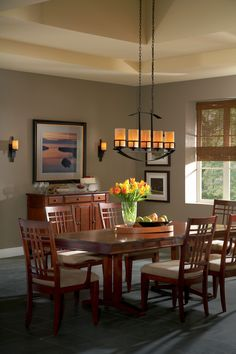 """Stunning this dining room is the """"Kyle"""" island chandelier corresponding wall sconces by Quoizel. Decor, Island Light Fixtures, Cool Lighting, Linear Pendant Lighting, Bronze Light Fixture, Dining Room Light Fixtures, Dining Room Lighting, Room Design, Dining Room Inspiration"""