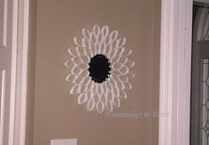 A great home decor craft: toilet paper rolls, $1 mirror, hot glue, spray paint and your good. I like it!