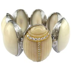 K. Brunini Jewels Taqua Nut Cabochon and Diamond Scarab Bracelet | From a unique collection of vintage modern-bracelets at https://www.1stdibs.com/jewelry/bracelets/modern-bracelets/