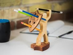 *** NEW - Two new pencil holder base styles now available *** The pen is mightier than the sword. Wait till you see what a pencil can do! No wonder it takes a true warrior to handle it. This stylish pencil holder in the shape of a brave warrior is h Kids Woodworking Projects, Woodworking Tips, Wood Projects, Woodworking Furniture, Popular Woodworking, Unique Woodworking, Youtube Woodworking, Woodworking Patterns, Furniture Projects