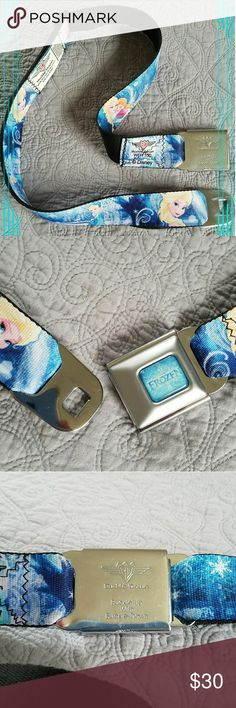 """Disney Frozen Seatbelt Buckle Belt by Buckle Down NWOT ~ never worn, only stored. Minor superficial scratching from storage as denoted in close-up pics of steel parts.  PRODUCT DESCRIPTION:  This seat belt-styled belt's vibrant hues and majestic Elsa motif add instant style and a snug custom fit to ensembles.  Adult size, 24-38"""" adjustable.  Steel / nylon Made in the USA  Note: This is a fashion belt and not a safety device Buckle-Down Accessories Belts"""