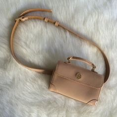 Christmas Sale! Tory burch Robinson belt bag Super cute belt bag from Tory Burch when you need your hands and shoulders to be free! Like new. Only problem is when it went on sale at a Nordstrom store, they wrote the price inside the bag with a marker! Other than that it is in pristine condition! Rose/blush pink color. *NO TRADES*. Sale. Originally listed for $125 Tory Burch Bags Mini Bags