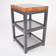 The welded steel frame and expanded metal shelving give this little side table some real heft, and a real industrial furniture feel. Stainless steel button head allen bolts secure the shelves and add a nice bright touch to break up the rough steel look. www.slipstreamcreations.com