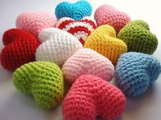 Crocheted 3D hearts.  A bowl of these would look so cool on my mantle. :)