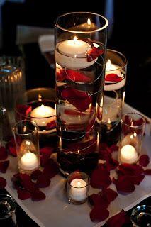 Velas OVNIS y cilindros con petalos como centros de mesa.... Candle Centerpieces-maybe white or peach rose petals?