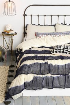 Really love the dip-dyed ruffles. Great base for colorful throw pillows. Noodle Boho Ruffle Duvet Cover