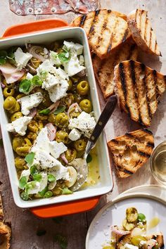 These Spicy Roasted Castelvetrano Olives and Feta with Oregano and Oil are perfect as an appetizer. But they can also be tossed into a pasta, served over chicken or steak and so much more! Appetizer Dips, Yummy Appetizers, Appetizer Recipes, Spicy Italian Recipe, Italian Recipes, British Dishes, Grilled Bread, Olive Recipes, Olives