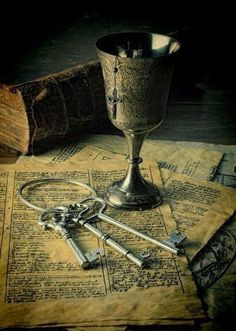 """The keys and the cup rested in the table, set aside for the sake of a book or the evening meal. As if they were simple objects, innocuous items you might find in any house rather than artifacts of ancient magic; held once by the most powerful wizards, fairies and princesses who are now only legend."" 