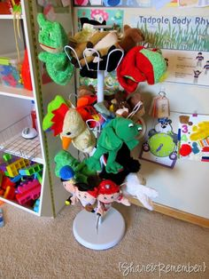 Puppet & small stuffed animal storage on a shoe spinner.